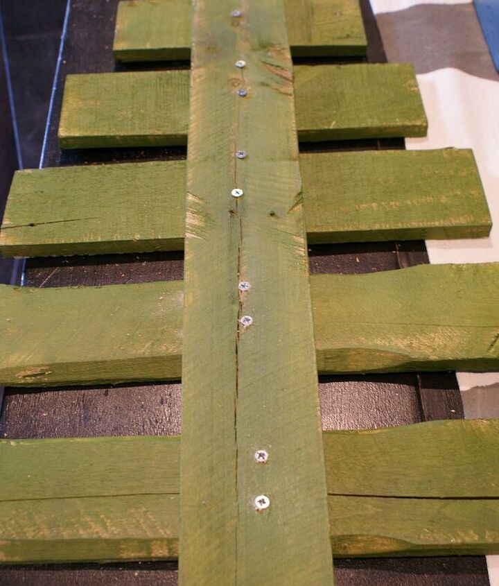 diy pallet christmas tree tutorial, christmas decorations, pallet, repurposing upcycling, seasonal holiday decor, Pre drill holes and screw the boards to the trunk Use 2 screws per board