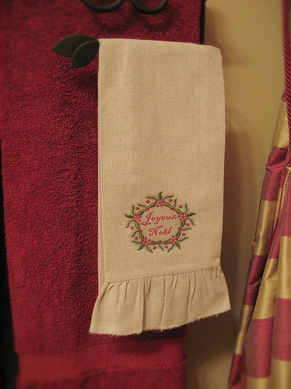 my french country guest bath, bathroom ideas, home decor, A pair of tea towels embellished with Christmas y embroidery look iron on transfers add to the d cor Link for the transfer here