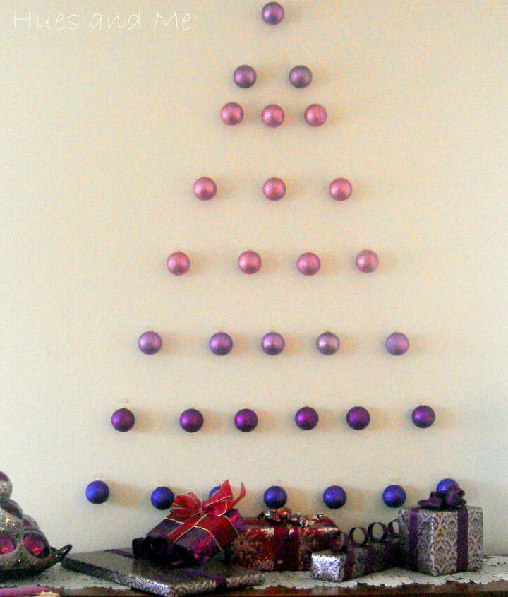 Ornament wall tree using unbreakable glitter ornaments and Command Strip Clips.