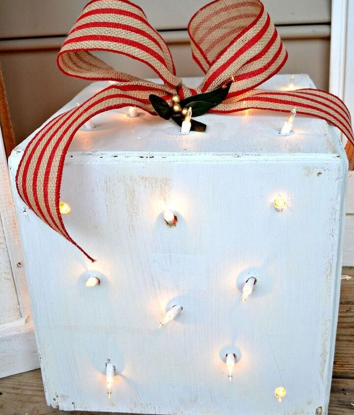 """This """"polka dot"""" box is the prettiest at night. I used a drill bit to make randomly spaced holes all over the box. They coincidentally ended up the right size for the twinkle lights to poke through each and every hole."""