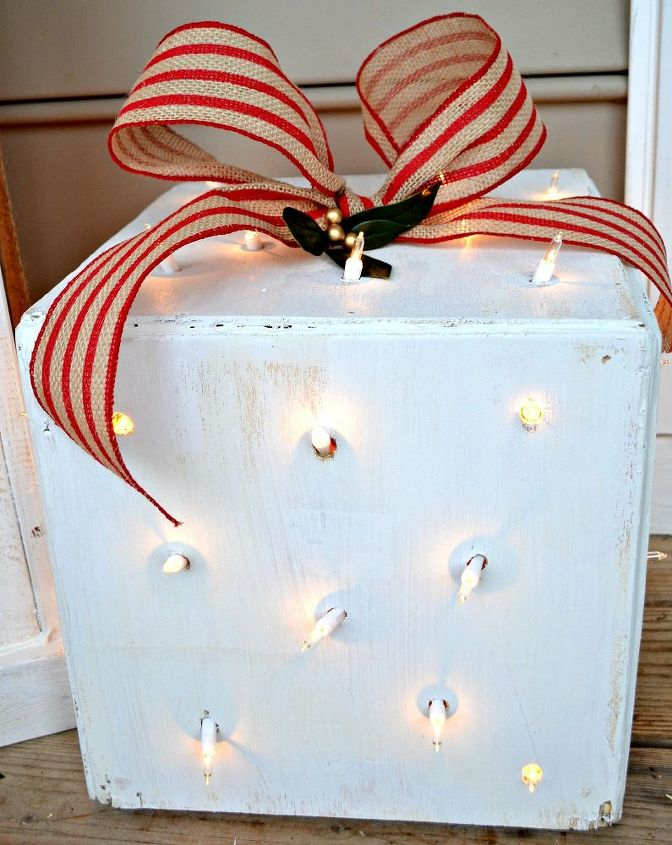 "This ""polka dot"" box is the prettiest at night. I used a drill bit to make randomly spaced holes all over the box. They coincidentally ended up the right size for the twinkle lights to poke through each and every hole."