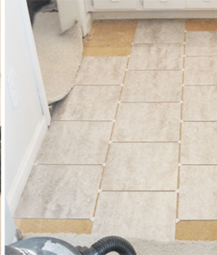 grouted vinyl peel stick tile, bathroom ideas, diy, flooring, how to, tile flooring, tiling, Before Carpet After Putting down tile with spacers