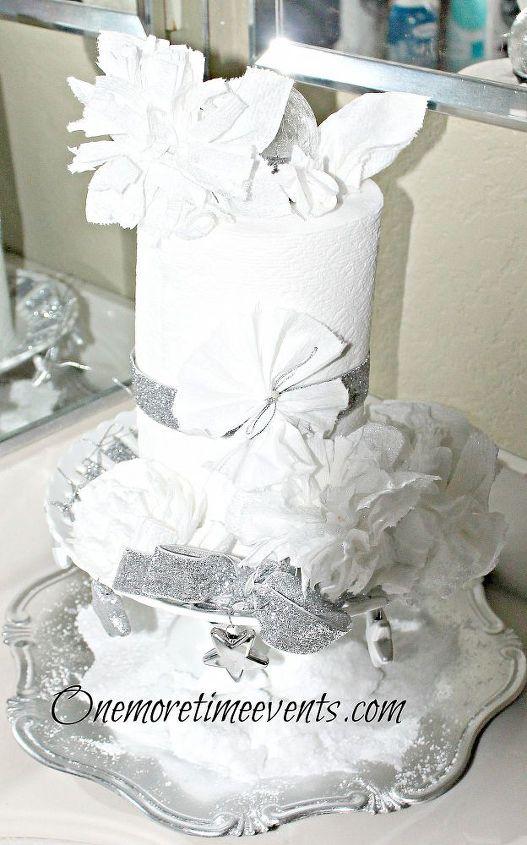 Tp placed on silver tray with Epson salt as snow.  Cake plate decorated wit silver ribbon and Tp flowers sprayed with glitter silver spray paint
