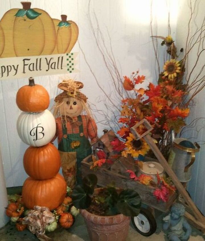 I put together the pumpkin tower and the sign on top was one I'd gotten at a crafts show. My husband removed the stake and positioned it on top for me. Our town has a yearly Scarecrow Festival. This one is my favorite !