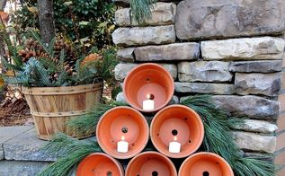 clay pot christmas tree, christmas decorations, outdoor living, seasonal holiday decor, Simply stack 6 clay pots and add candles I added a little pine to add to the tree look