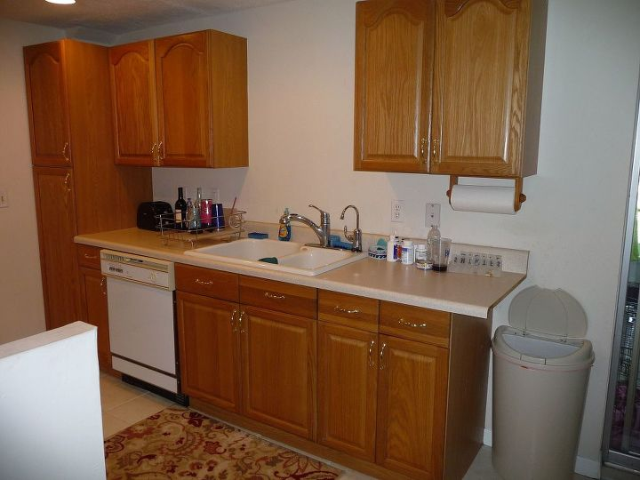 Before...oak cabinets, misfitted countertop, blah paint