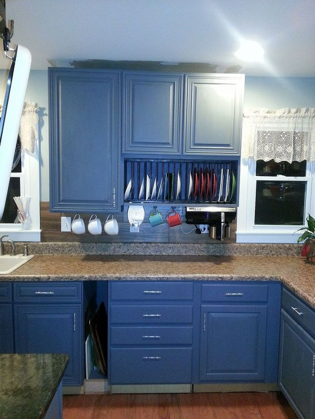 I built the plate rack with wooden dowels. The cabinet was a 12 cabinet and I removed the door and put it sideways. Best thing I ever did with kids. that slit in the bottom cabinets house cookie sheets and cutting boards