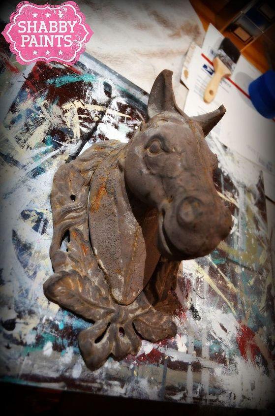 Before Rusted metal horse head.