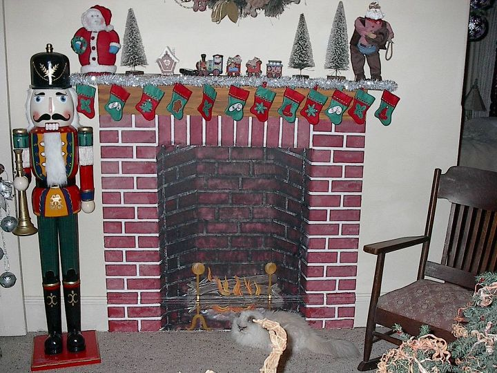 this fireplace is in the Christmas room. It now has an antique mantel and many Christmas items scattered in front of it.  Thats Cybil laying in front of it.  Now in Heaven with Teegie.
