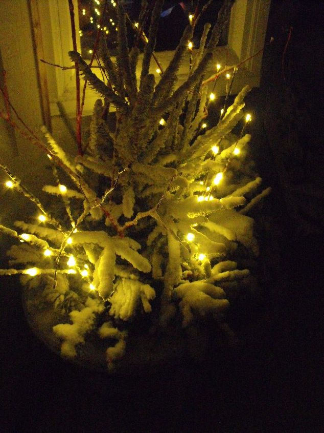 Winter container with newly fallen snow-with the twig lights showing off the beauty of the snow.
