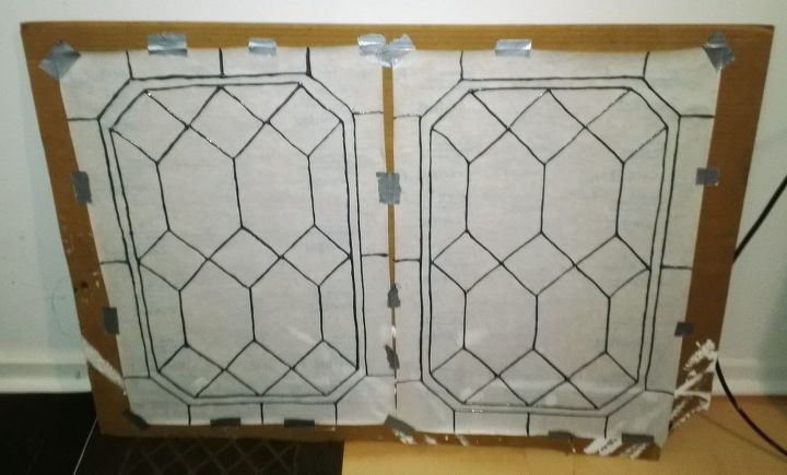 This is two after the lead is applied and before the color.   I use the squares on the back to make everything even.