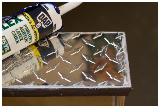 """You want to cut the diamond plate about 1/4"""" shorter than the drawer.  Then you need to chaulk around the edges."""