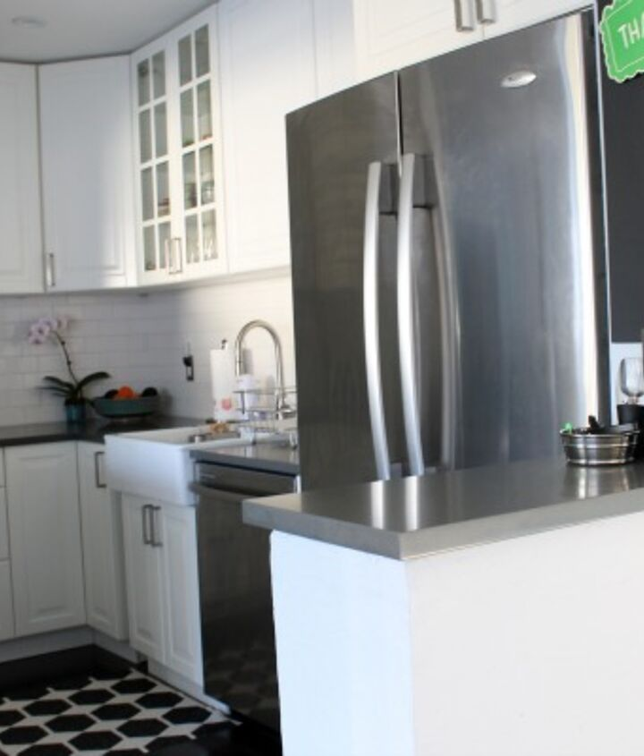 IKEA cabinets, gray quartz counters, white subway title, dark hardwoods. For a complete kitchen gut job, this was made it easier on the budget.