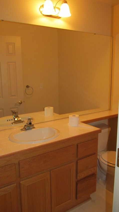 BEFORE: Powder Bath had banjo style white tile counters and oak cabinets. Modern style faucet & light fixture. White Vinyl Floor.