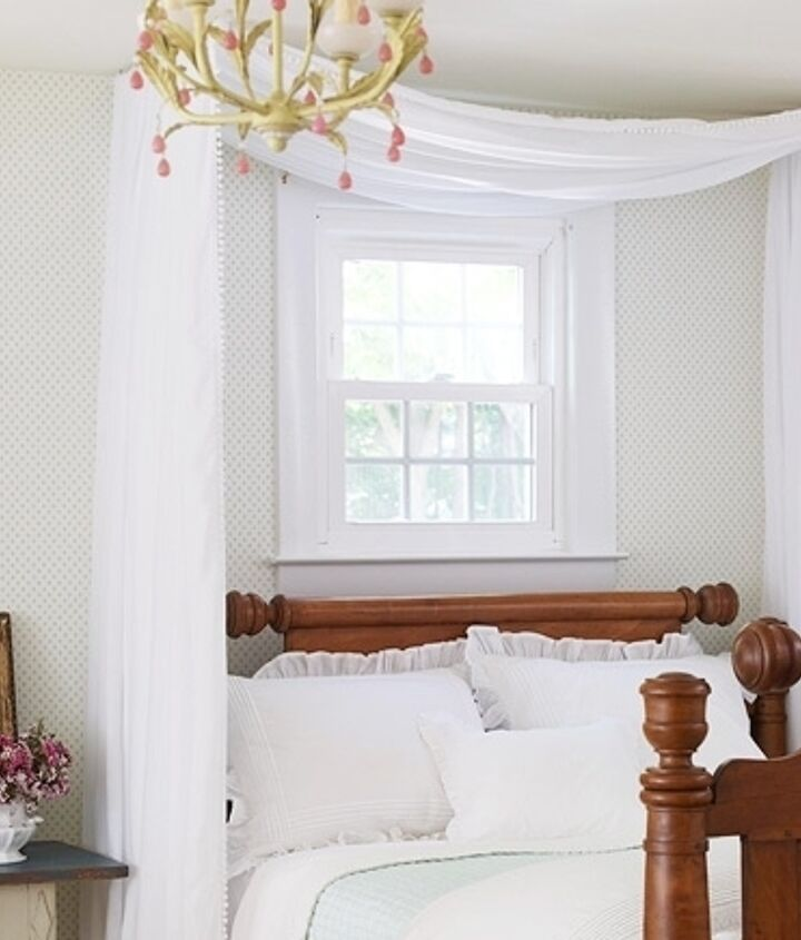 Two curtain rods create this simple fabric canopy