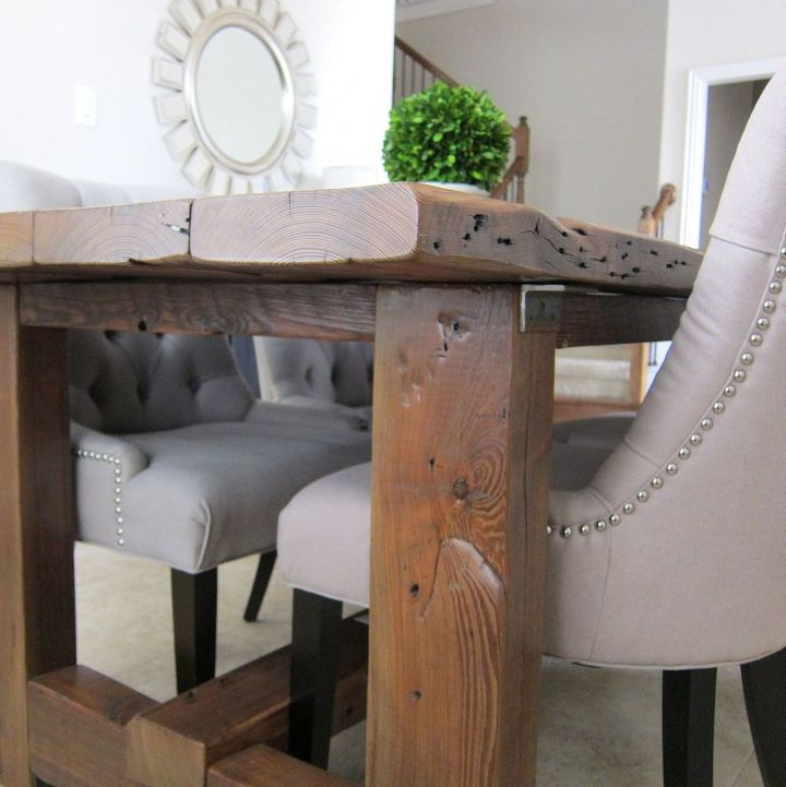 Our dining room table we made from reclaimed wood hometalk for Wood dining table decor