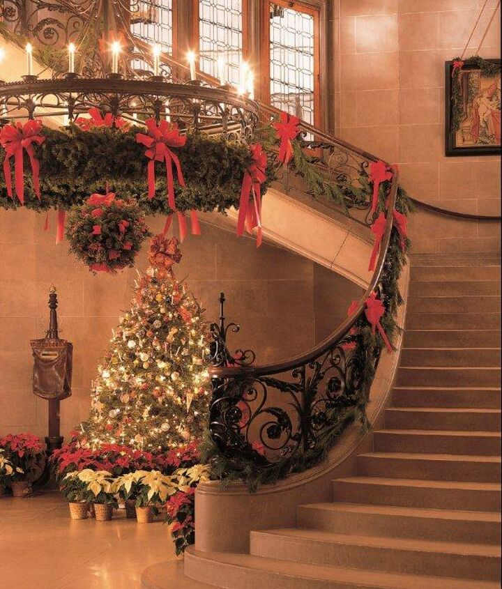 The Grand Staircase is twined with evergreens, filling the 250 rooms with the scent of Christmas