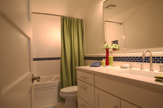 here is a hall bathroom that was in need of help the homeowner called in a panic, bathroom ideas, flooring, home improvement, plumbing, tile flooring, Subway tile with some character with a tile wainscott and tile chair rail around the room created just the look our homeowner was trying to achieve