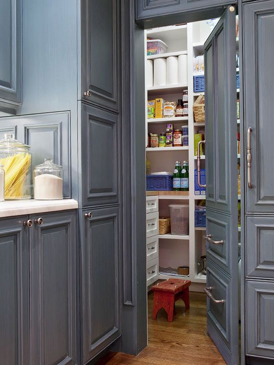 A door that looks like a cabinet is a great idea to hide your pantry away.