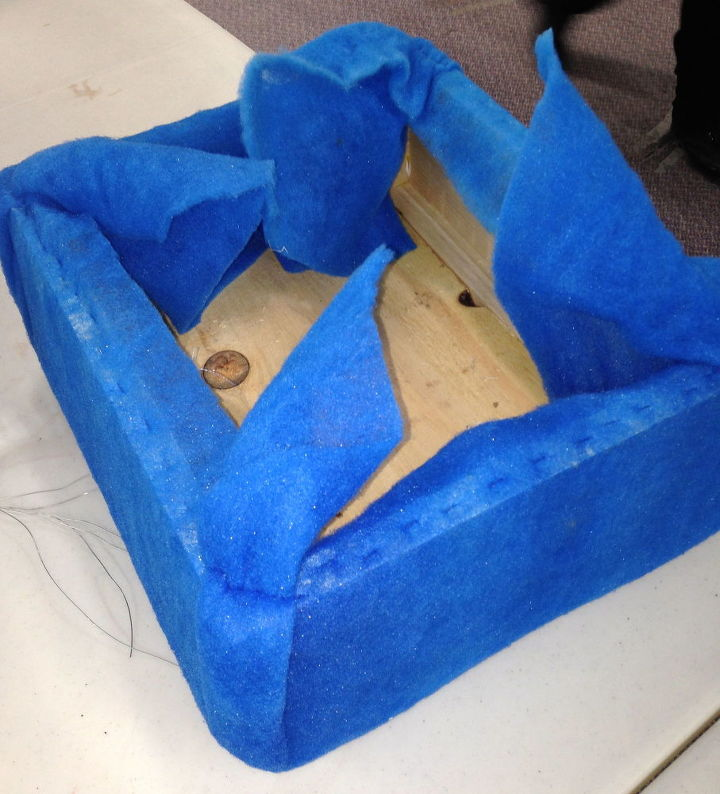 """A layer of 2"""" foam and some protective batting cover the entire box. A nail gun fitted with small staples works well to secure the fabric."""