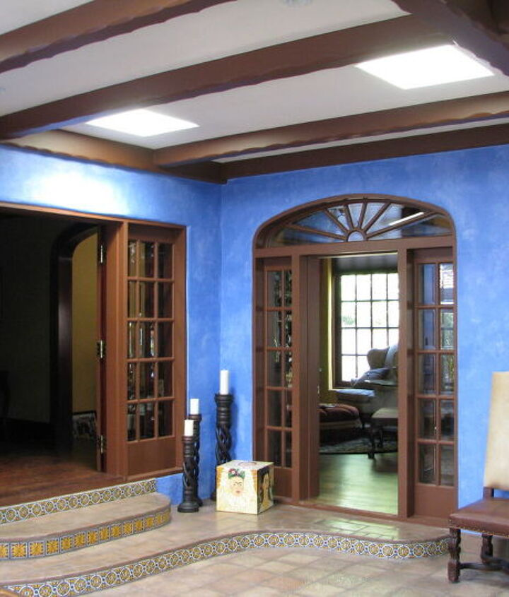 After we rebuilt the roof and installed four skylights we rebuilt the steps to the adjoining rooms and redid the floor coverings in a more appropriate manganese floor tile..