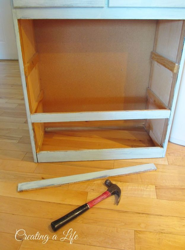 I removed the 3 larger bottom drawers and tapped out the cross pieces with a hammer.