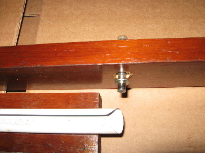 Spice Rack made of scrap parts,curtain rod,bi-fold closet door hardware,wood. Slides out and swivels.Holds 9 or 10 spices. Spices can be kept in place with elastic band. Project not complete, but you get the general idea.
