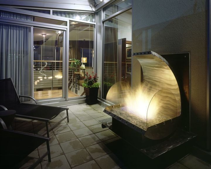 Custom designed outdoor fireplace in Stainless steel and copper