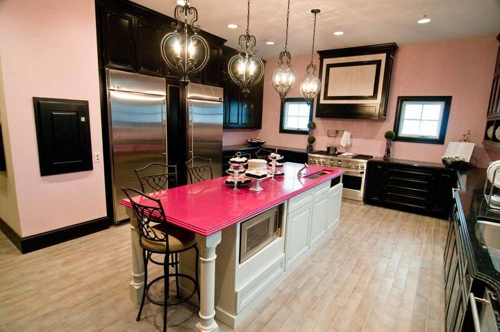 how to use unique colors in your kitchen, home decor, kitchen design, kitchen island, Interior Design By Eva Zellmer and Veronica Valencia ABC s Extreme Makeover Home Edition designed this kitchen for an all girls home They used the Pink Love Silestone countertop on the island as the focal point for the kitchen The rest of the space is more neutral in tone