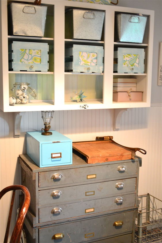These gray drawers were a gift from my brother. All I did was clean them up before bringing them into the house. The wall cabinet is an old kitchen cabinet that my parents gave me. I removed the doors and put bead board planks on the back, then painted it and added corbels.