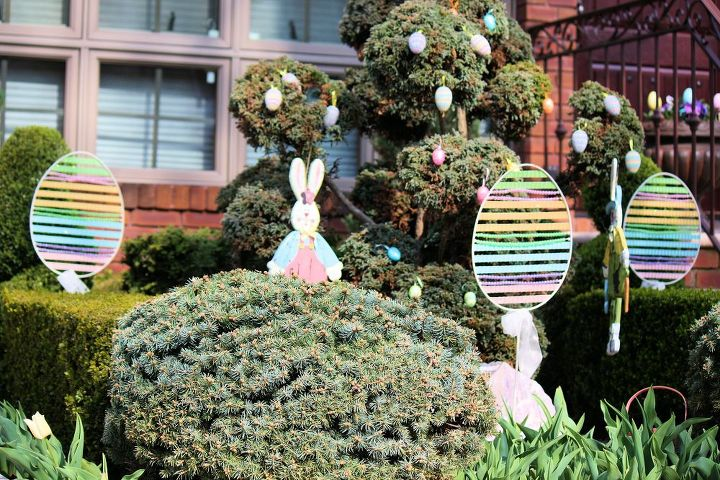 An Easter bunny hiding behind a shrub!