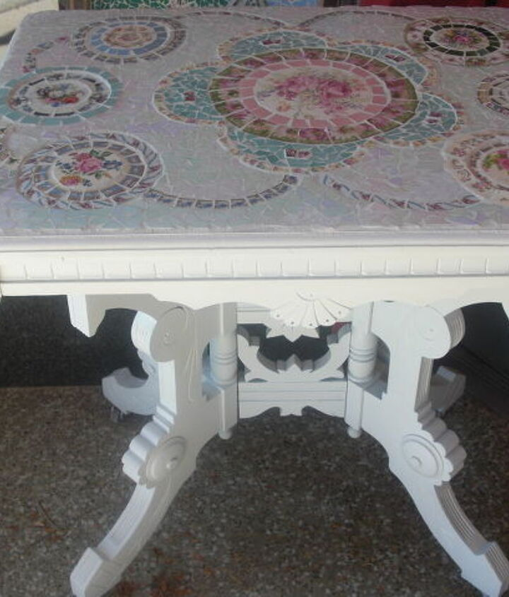 This is a commission piece I did for a woman.  This table was her grandmother's and the top was not in the best of shape.  She wanted it painted white and told me to do any design I wanted out of pastel colors.  When she came to look at it, she was overwhelmed because one of the dishes (unbeknownst to me) was some identical dishes that her grandmother had.