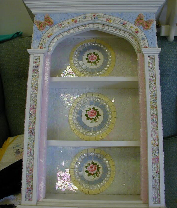 This is a curio cabinet that is heavy and sets on a table.  It is made out of beautiful china, stained glass, and kiln-fired butterfly designs.