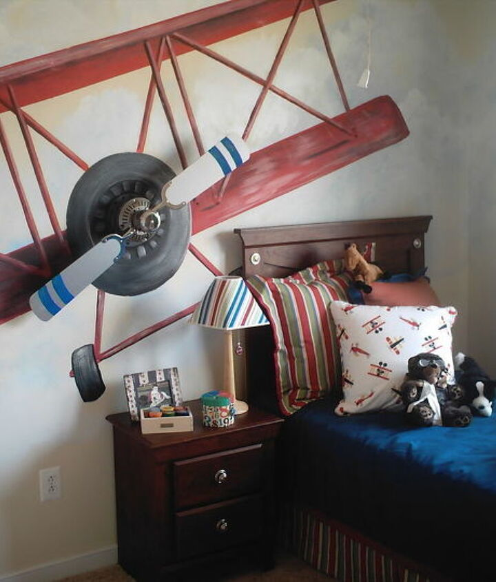 A ceiling fan was mounted on this wall for a fun 3-D look.   The blades spin manually.