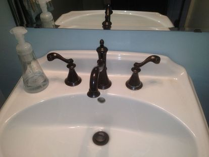Oil Rubbed Bronze Faucet By Delta With Hard Water Deposits