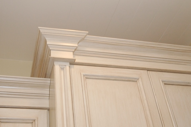 "Add columns 1-2"" deeper, this transition makes a big statement in the crown (light rail and baseboard) moldings"