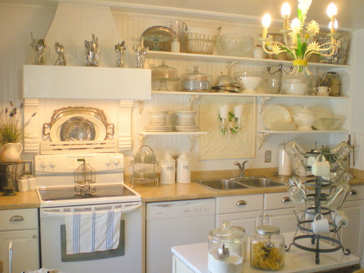 A hymnal rack from the back of a pew hangs above the stove and creates a place to display favorite platters.