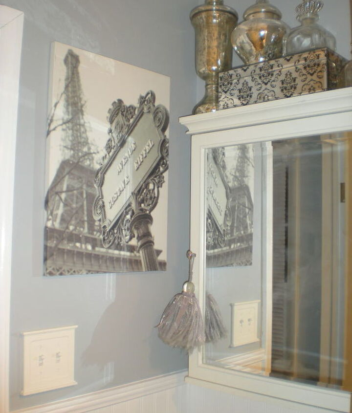 The Eiffel Tower photo was my inspiration for the color scheme of the room. The medicine cabinet was $7.00 at a yard sale.