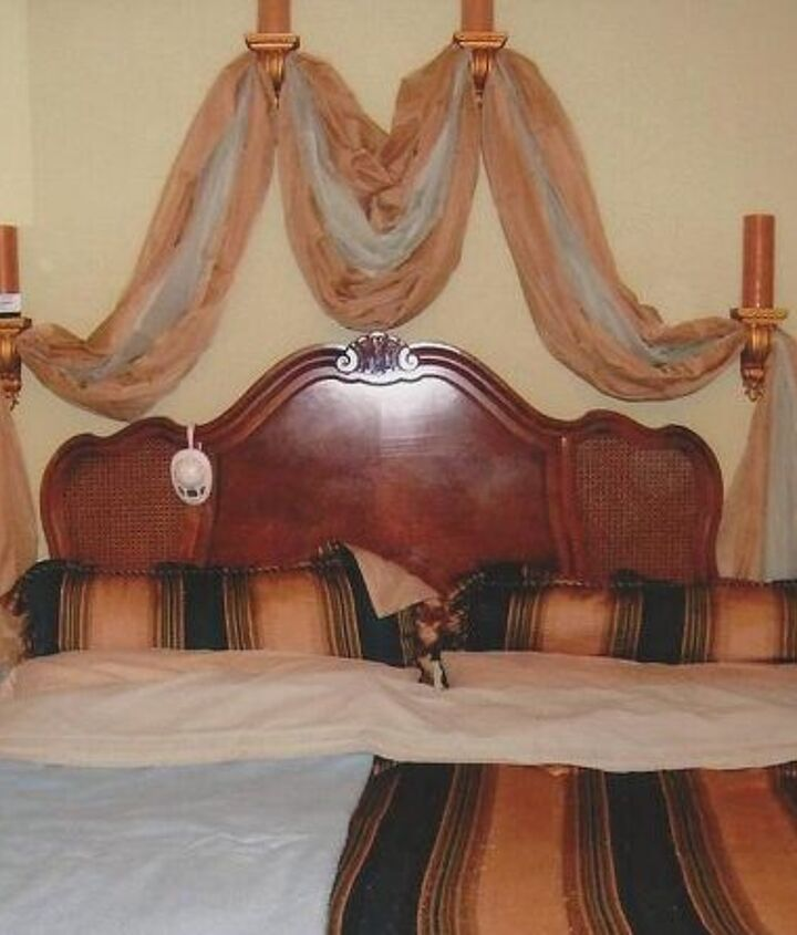 Picture showing how the scarves are entertaining/distracting the eyes in order for one not to notice the two different widths between the headboard and the mattress.  If one looks closely, one could very well see the big difference in both of the widths