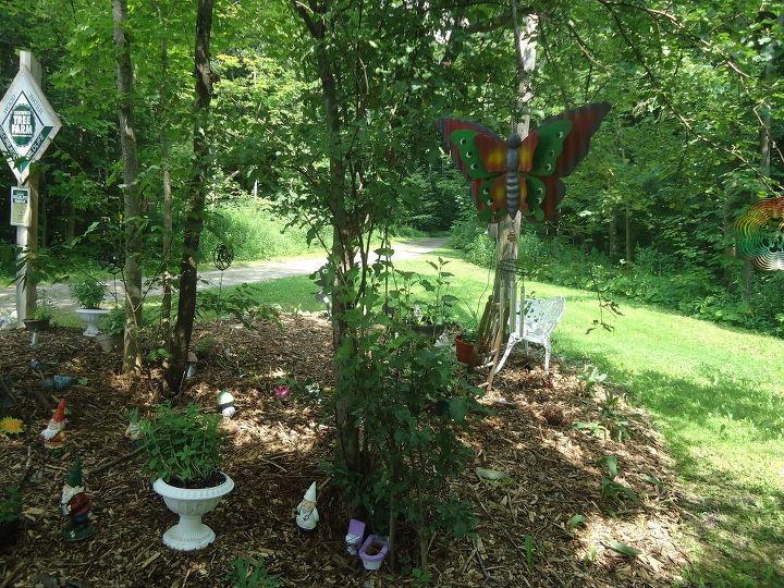 a fairy garden sanctuary, flowers, gardening, landscape, outdoor living