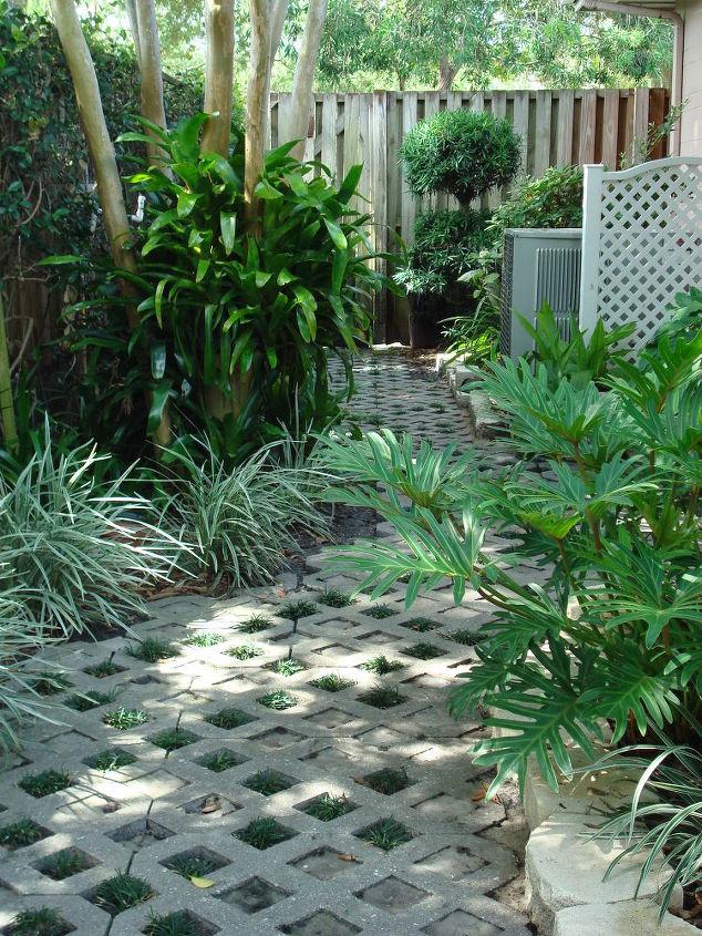 Shade loving plants; turf or matt block; polymeric sand w/dwarf mondo planted in a diamond pattern along the pathway.