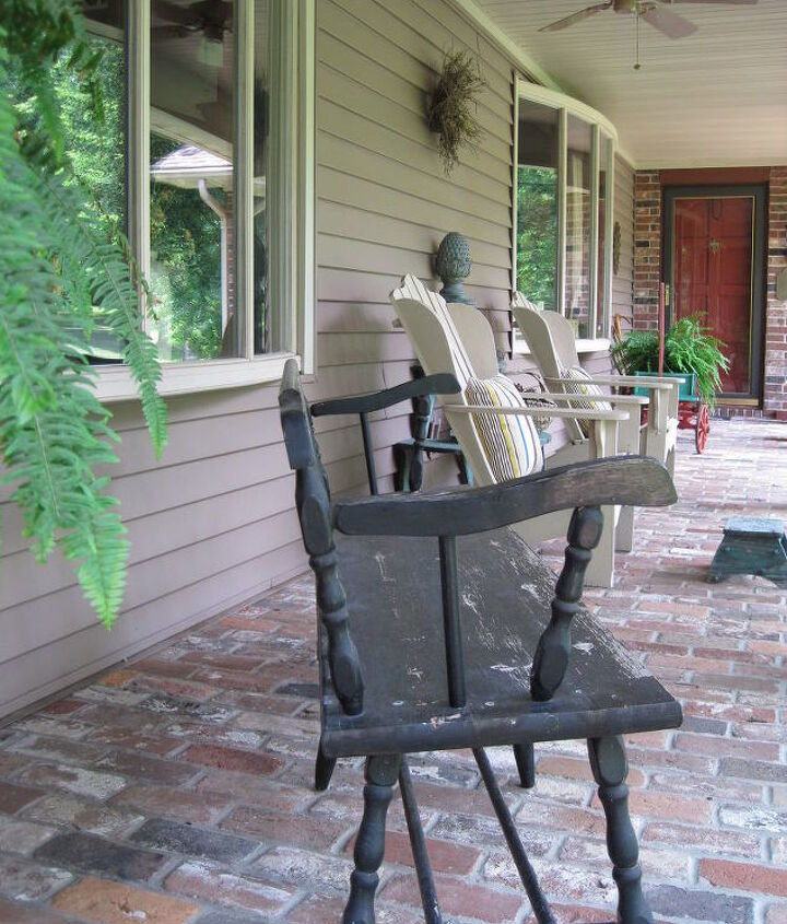 Recycled bricks on front porch /keeping room and screened porch .