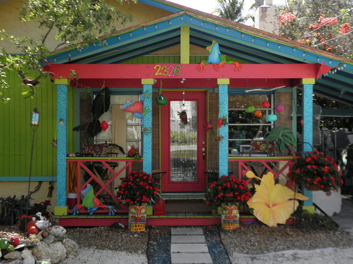 . Zebra painted columns, Tiki painted coconut trunks, my hand-cut treefrog art and hibiscus. Front porch in Coconut Grove (Miami) Florida; home of local artist Jennifer Matthews www/JenniferMatthewsArt.com
