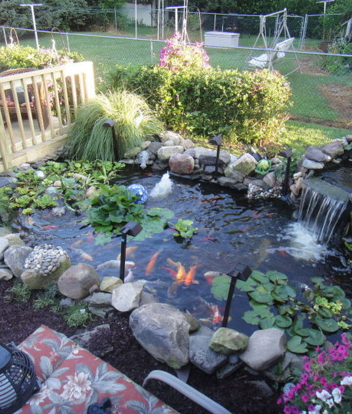 my husband just built me this really nice deck overlooking my pond! this is where i spend most of my time relaxing after a very stressful day! my own little paradise!