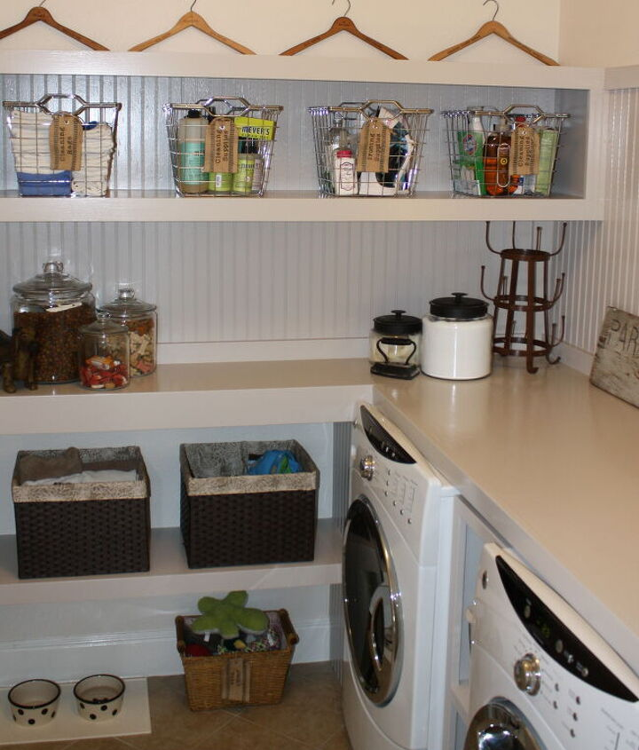 We incorporated shelving for storage in with the folding table over the w & d...