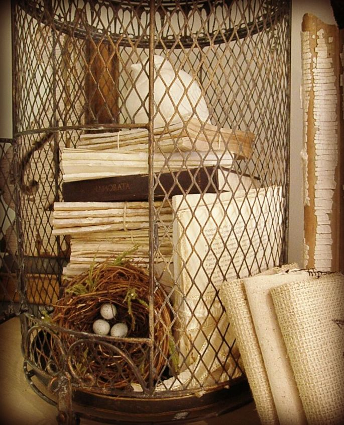 all tore up or books in a birdcage vignette, crafts, home decor