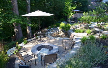 from sloping lawn to a backyard oasis, decks, outdoor living, ponds water features, View to the lower level fire pit and waterfall