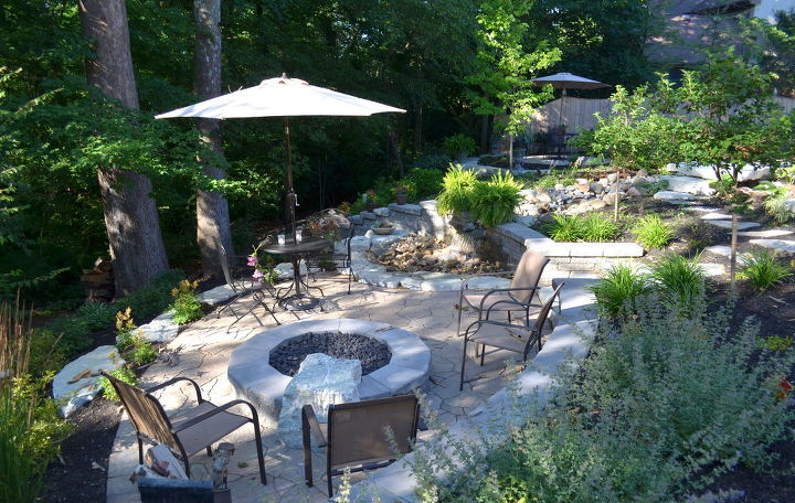 View to the lower level fire pit and waterfall.