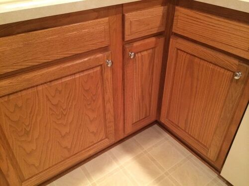 Which hardwood with honey oak kitchen cabinets hometalk for Ceramic tile under kitchen cabinets