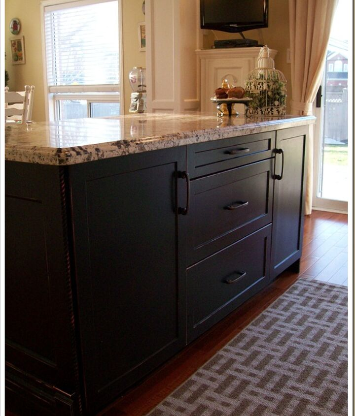 Black island was created with kitchen cupboards from Home Depot.  More MDF was used with the same design as the door profiles to enclose the back.  Painted black for a nice contrast.